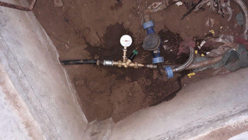 Nyomáscsökkentő beépítése vízóra aknában